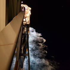 Night balcony view looking to front of ship